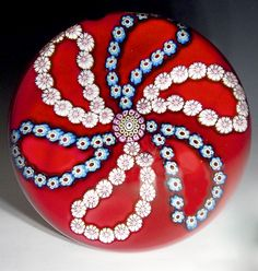 """Saint Louis {France} paperweight - Looped millefiori garlands over red ground. 1973, 3 1/4""""w x 2 1/4""""t, 25.5 oz. - #0606"""