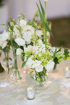 Peony, parrot tulip, hydrangea, rose, orchid, Lily of the Valley, and quince centerpieces | Brides.com