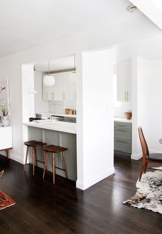 dark wood, white walls, cabinet color, brass pulls... love it all! // via smitten studio