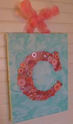 "Your Baby's Initial in Buttons on 9""x12"" Canvas -- by Letter Perfect Designs. $65.00, via Etsy."