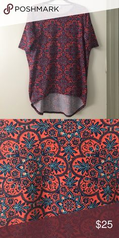 LuLaRoe XXS Irma In excellent condition!  Only worn once or twice.  No stinks or stains.  Pretty coral and blue. LuLaRoe Tops