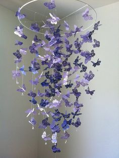 I LOVE THIS and got it for Luna's nursery!!! Custom made with three shades of lavender to match Luna's new nursery walls!    Monarch Butterfly Chandelier  Mobile  purple by DragonOnTheFly, $55.00