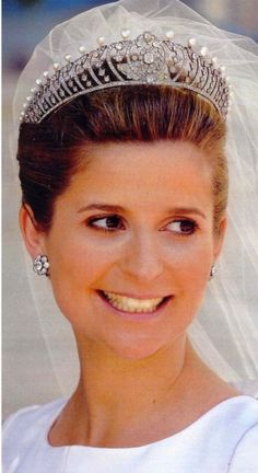Diana Alvares Pereira de Melo, Duchess of Cadaval married Prince Charles-Philipped'Orleans, Duke of Anjou, wearing  tiara with more than a century's history in her family, which was used for the last time at the wedding of the bride's great grandparents. It's an exquisite jewellery piece with diamonds and pearls, set on white gold.  http://nobilitynews.blogspot.com/2008/06/royal-wedding-in-cathedral-of-vora.html