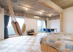 Dabs of plaster pattern the raw concrete surfaces in this Tokyo bedsit.
