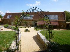 Tithe Barn with beautiful garden surroundings.