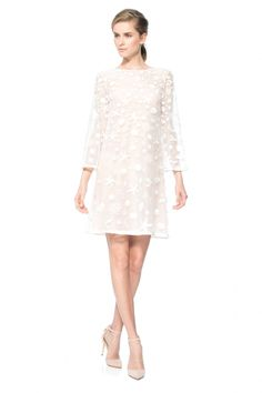 Shine in this feminine starfish embroidered tulle long sleeve gown.
