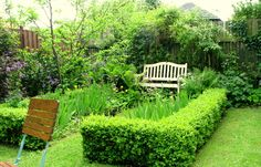 Another view of the orchard corner and bench.