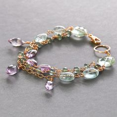 Moss Aquamarine, Pink Amethyst, Parasiolite Rose Gold Filled Bracelet    This is a three strand rose gold filled bracelet $160 CAD