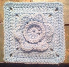 Framing Flower 6 inch square crochet pattern- this site has many free crochet square patterns