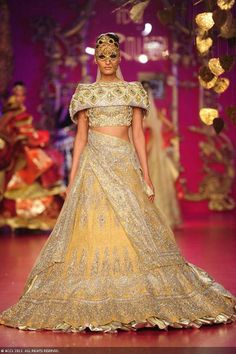 Gold and yellow lengha by Ritu Beri at Delhi Couture Week 2013. bridal couture for a south asian bride