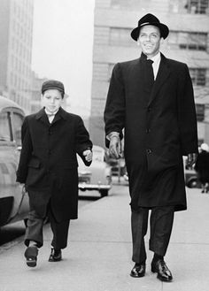 Frank Sinatra and his son Frank, Jr. talking a stroll down First Avenue in New York City, 1954