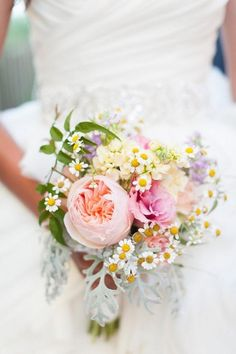 Boho brides can express their style by using roses, billy balls, tiny daisies, and peonies @myweddingdotcom