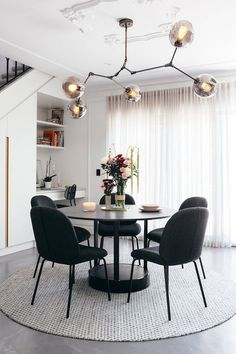 Replica Lindsey Adelman 'Bubble' chandelier from Lucretia Lighting; 'Bella' dining chairs from GlobeWest; 'Mila' dining table from Nood Co. Glass Round Dining Table, Modern Dining Table, Black Dining Chairs, White Chairs, Black Round Table, Circle Dining Table, Black Dining Room Table, Glass Table, Lounge Chairs