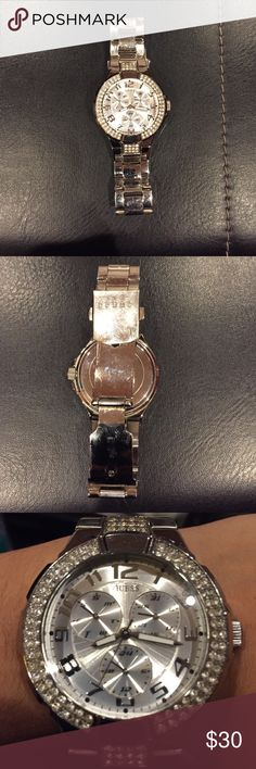 Guess Silver Watch with jewel encrusted face Sold as is. This watch is well worn but has plenty of life with just a new battery. It is not missing any of the jewels. Suggest purchasing if you have smaller wrists as extra links are not included. Guess Accessories Watches