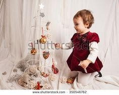 Studio portrait of two year old girl with white background. - stock photo