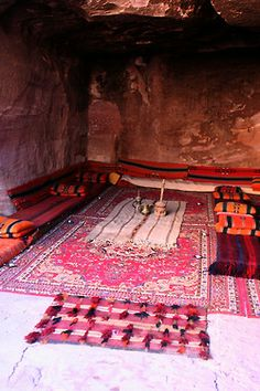 thepicketysatyr:  Bedouin home, Petra, Jordan  (I did my field school in Petra. The Beduin like to live in the rock-cut tombs as shown in the image, and the government pays them to stay out and live in the nearby village, Umm Sehoum, to leave the tombs empty for tourists to visit. There's always a few holdouts though - the tombs are nice and cool in a hot part of the world, and conveniently already carved out!)