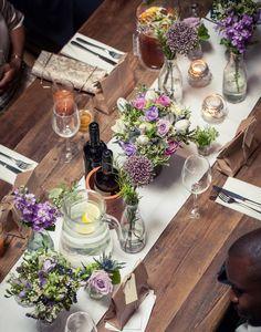 Top Table lilac milk bottle flower arrangement http://www.missvictoriasfloralemporium.co.uk/