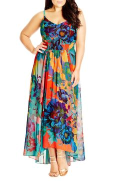Bright and cheery plus sized floral maxi dress. Beautiful colors and flowy fabric for summer. #AffiliateLink