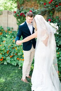 Awesome groom attire - navy coat with floral shirt and tan linen bowtie and pants. Open back lace wedding gown.  Romantic blush backyard Arizona garden wedding by Pinkerton Photography, Arizona Wedding Photographer.
