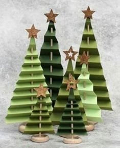 Best 12 Learn how to make a folded paper tree forest for your holiday mantel! Best 12 Learn how to make a folded paper tree forest for your holiday mantel! Handmade Christmas Decorations, Christmas Crafts For Kids, Diy Christmas Ornaments, Rustic Christmas, Xmas Decorations, Christmas Projects, Simple Christmas, Kids Christmas, Holiday Crafts