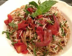 Whole wheat spaghetti, fresh tomatoes, garlic, red onions, extra virgin olive oil, lots of basil and a soupcon of red wine. Yum.