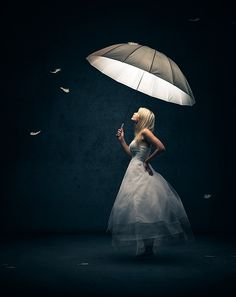 Photograph Girl with Umbrella and feathers by Johan Swanepoel on 500px