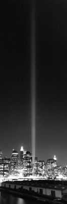 Vertical panoramic black and white photography of the WTC memorial light tower in New York City