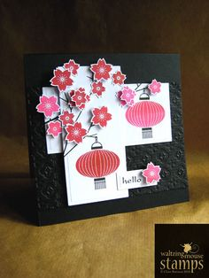 handmade card ... Asian Gardens Additions from Waltzingmouse Stamps ... black and white with pinks ... lanterns and cherry blossoms ... luv the look of embossing folder embossing in the background on a wide side to side panel ... fab card!!