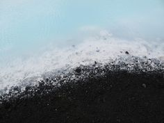 Volcanic rock, silica and water at the Blue Lagoon, Iceland. (Yes, I took this photo. Yes, that really is the natural color of the water.)
