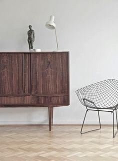 herringbone floor, vintage credenza, diamond chair