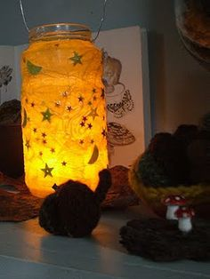 apply your sequin stars and moons. then cover with tissue paper while the glue is wet, smoothing out any air bubbles.    :: after the jar is covered, you will want to add another layer or two of tissue paper. lightly brush a layer of decoupage glue over each layer of tissue paper.