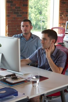 Two members of the Fresh Tilled Soil team collaborate on a project. #WebDesignBoston #UX #UI