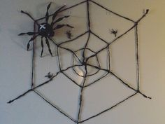 DIY Halloween spider. Web made of braided cutout trashbag strings. Spider made of trashbags, straws and tape 👌
