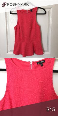 Hot Pink Peplum Blouse This closely detailed peplum top is in good condition and has been barely worn. It has a zipper down the back of the shirt as well Express Tops Blouses