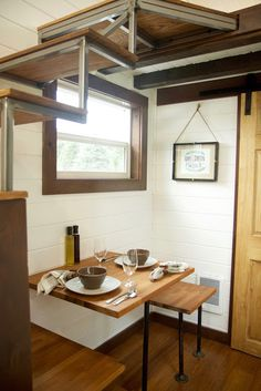 Like this dining area, tucked away with window above.