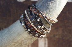 """Genuine Leather  Swarovski Crystals, Pearls and Metal Studs   Adjustable two snap closure   Will fit a 7 1/4"""" to 8"""" wrist   Handcrafted in Missouri    Classy Cowgirl Co- Gypsy Cowgirl ,Fun & Funky Western clothing, jewelry, & Accessories by Lane Boots, Junk Gypsy, R. Cinco Ranch,Hooey, Vocal, Ali Dee, Pink Panache, ATX Mafia, Urban Mangoz, Montana West, L&B, Beaver Soap, Crazy Train, cowgirl tuff, Liberty black boots, Classy Cowgirl Co, Southern Grace, Sbicca Shoes, Jewelry Jun..."""