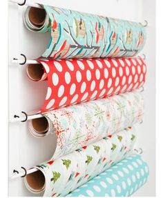 Stubborn's Place | Neat IDEA!!!!!! Create a thrifty organizer for wrapping paper using cup hooks and painted dowel rods. This technique is also ideal for storing rolls of foil, kitchen roll and grease proof paper on the inside of pantry doors. via: Woman's Day