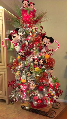 Pinner said: I made my granddaughter a Disney tree. I did it the same way you would make and elf tree. Instead of elfs I use plush Disney characters in all sizes. Wiring them on. I added lighted Walmart candy canes made to be placed in the yard, and lighted packages made to be used as decorations. I also made my own ornaments that you can find on my Christmas board.