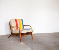 mid-century chair upholstered in pendleton blanket