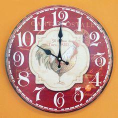 Relógio de Parede Vermelho Galo - 33.8x33.8cm - Relógio de parede com base em MDF cortado a laser e estampado. Ponteiro de minutos com movimentos contínuo a cada segundo. Dois ponteiros: Minuto e Hora Mecanismo: Step Material MDF estampado Alimentação 1 pilha AA 1.5v Suporte para pendurara moldura na parede. Tamanho:33.8x33.8cm