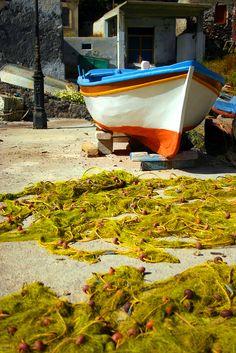 Boat and fishing nets in Aegina - Greece