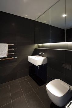 Dark Tiled Bathroom, Vaucluse House in Sydney, Australia by MPR Design Group