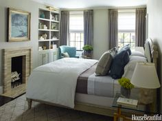 Soft teal blended with gray and green give the master bedroom its serene atmosphere.