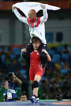 Eri Tosaka of Japan celebrates winning gold with coach Kazuhito Sakai over…