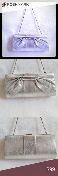 "ALDO Silver Bow Hard Sided Evening Clutch w Chain ALDO hard sided silver evening bag with removable chain strap. Kiss lock closure. Large pleated bow detail. Bag measures approx 9"" x 4 1/2"" tall x 2"" thick. Chain strap adds about 8"" to height. Icy silver gray lining. Small interior pocket.  Excellent used condition. Smoke free and pet free home.   Check out my other listings - 100's of 👠shoes👠, 👢boots👢 and 👜bags👜. Bundle 2 or more and save money!💲💰💲 Aldo Bags"