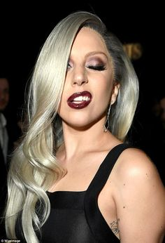 Well red: Lady Gaga's lips were painted a deep shade of burgundy, while she donned a long,...
