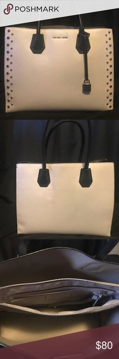 Michael Kors Purse with original dust bag Used Michael Kors purse see pics for some signs of usage other than that still in pretty good condition. The inside and outside still clean. Michael Kors Bags