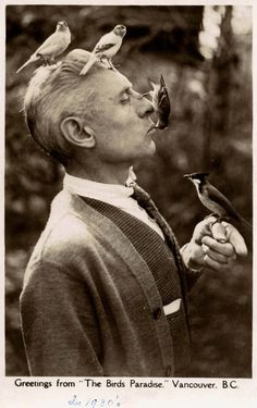 """The Birds Paradise, 1930s Charles E Jones was known as the """"Birdman of Vancouver."""" This and other photos of Jones and his birds appeared in the 24 February 1941 issue of Life Magazine. Jones became Vancouver's mayor in 1947.  Source: BC postcard collection at SFU Special Collections"""