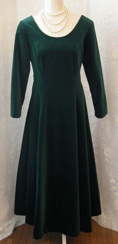 *DESCRIPTION: Absolutely gorgeous 1980s holly green velvet full length evening gown by Laura Ashley. Bodice features a low scooped neckline