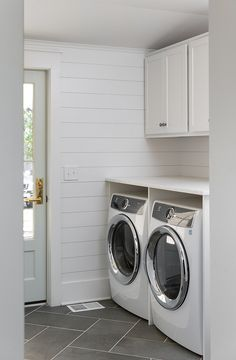 The laundry room features white shiplap painted in Benjamin Moore White Dove and.The laundry room features white shiplap painted in Benjamin Moore White Dove and a grey slate floor tile BenjaminMooreWhiteDove LaundryRoom with door hardware White Laundry Rooms, Mudroom Laundry Room, Farmhouse Laundry Room, Laundry Room Design, Laundry Hanger, Laundry Drying, Laundry Storage, Grey Slate Floor Tiles, Slate Flooring